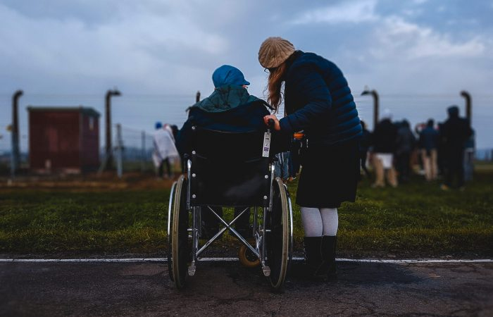 two people, one in wheelchair