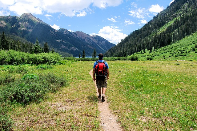 person hiking in mountains