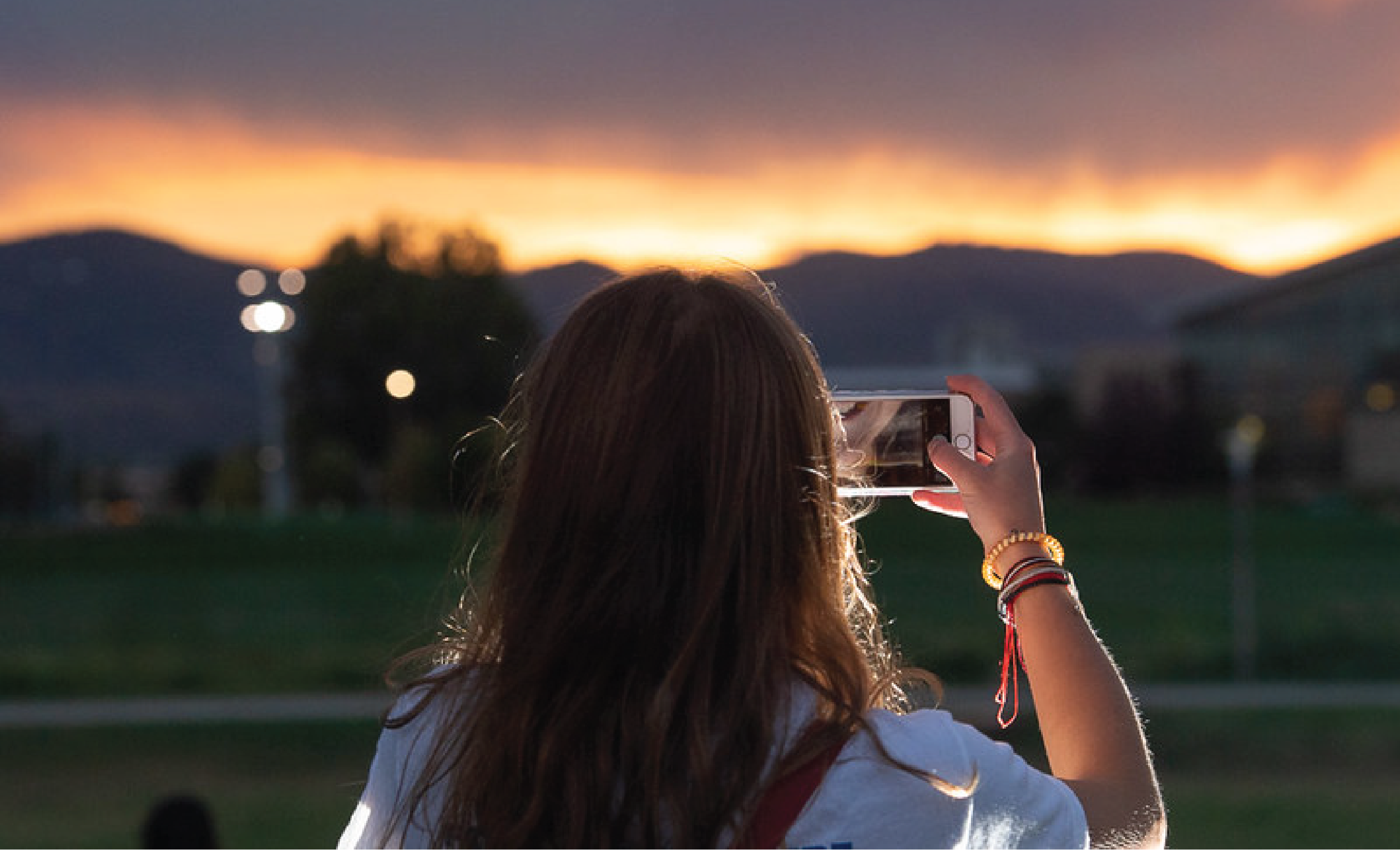 A student taking a picture of the mountains