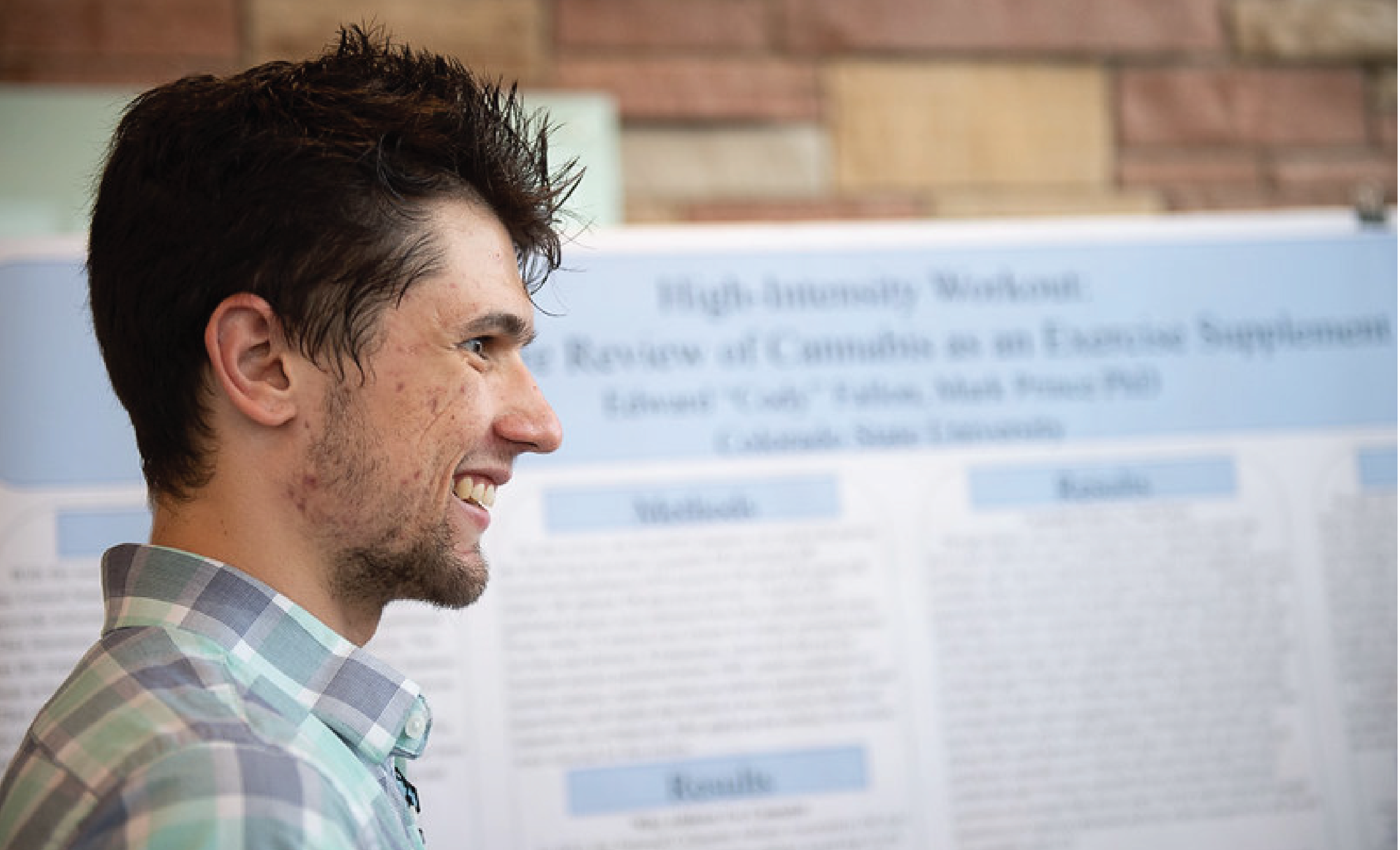 A student showing their research poster