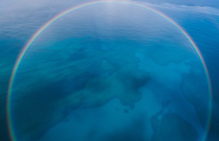 Rainbow over an ocean.