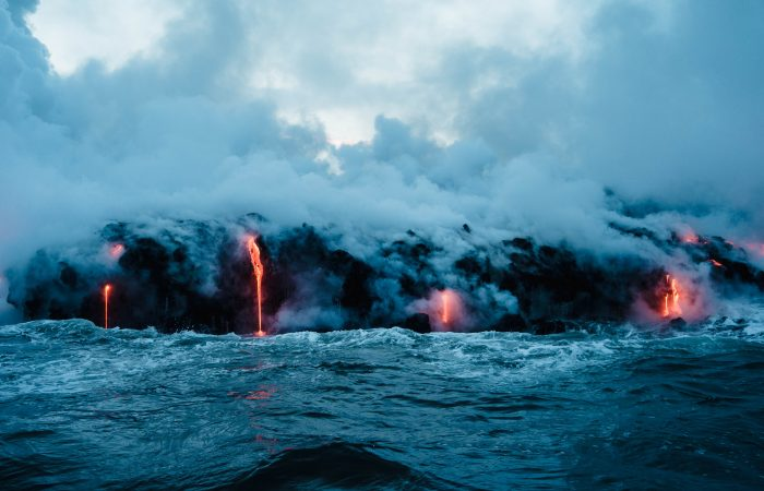Lava spilling into water.