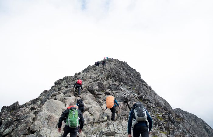 People hiking a mountain.