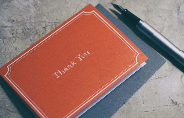 A thank you note with a pen next to it.