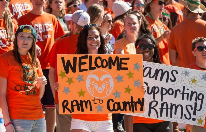 student holding welcome to ram country sign