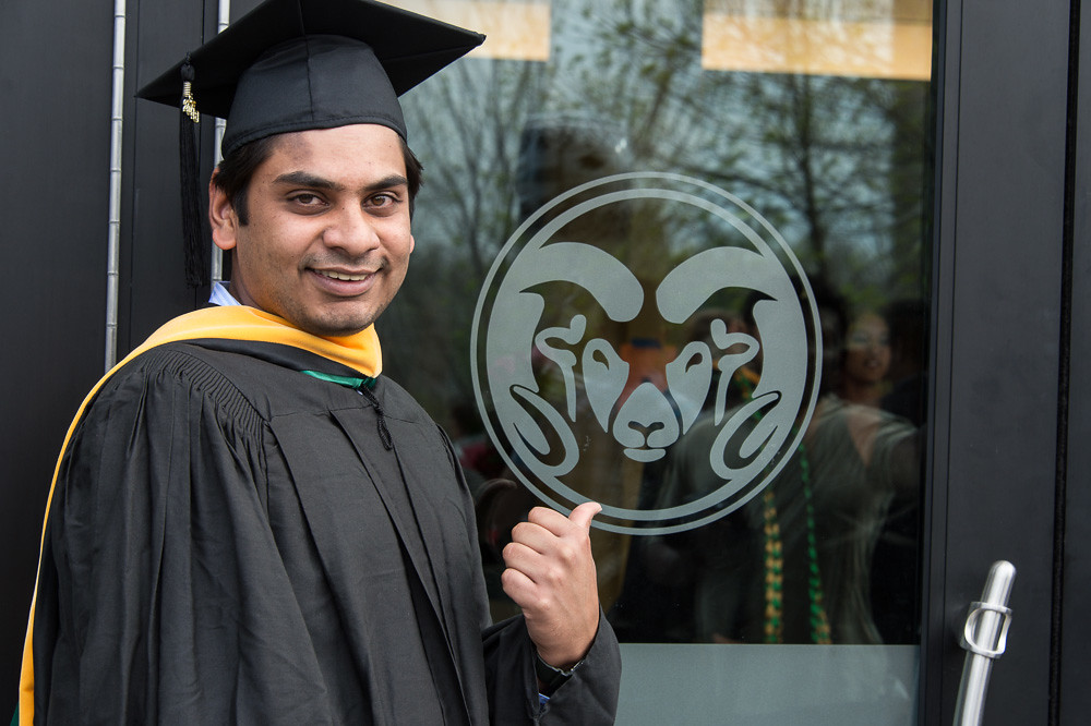 student grad with rams head
