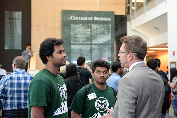 College of Business students meet with a perspective employer - image