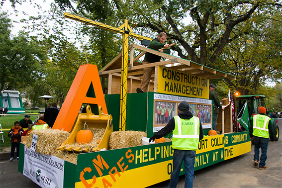 Image - Construction Management Student assisting parade float that demonstrates how they assist the community