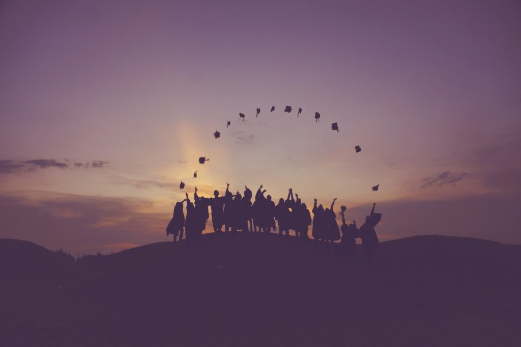 Individuals celebrating in the sunset - graduate school