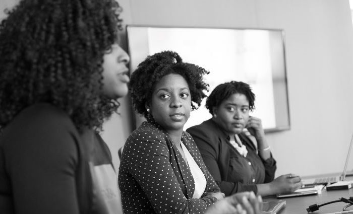 women of color in a meeting