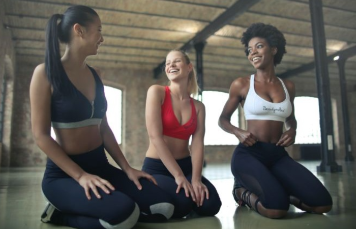 3 women sitting in a gym