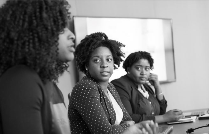 Three Black women sitting at a conference table