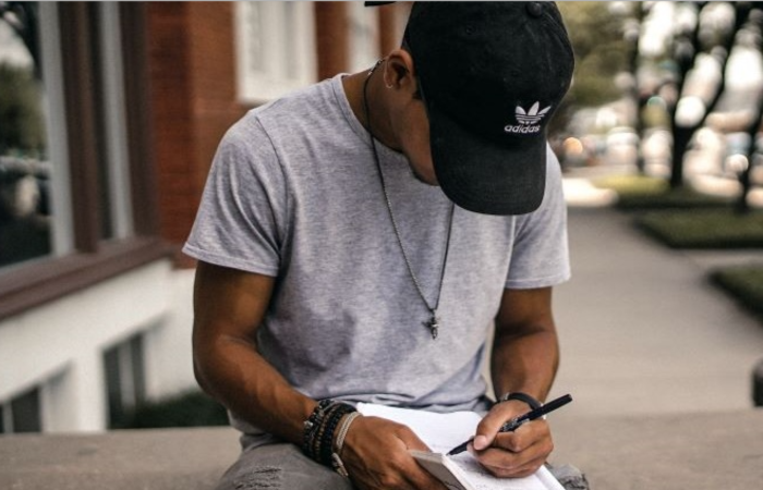 Black man writing on a notepad