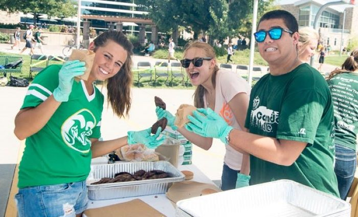 student employees grilling burgers