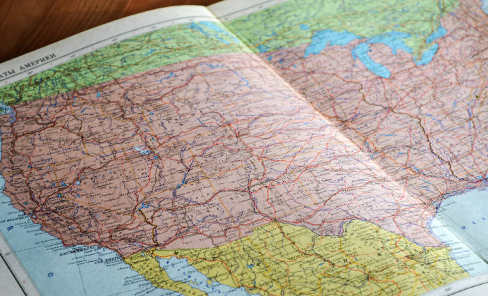 Picture of a book opening to a map of the USA