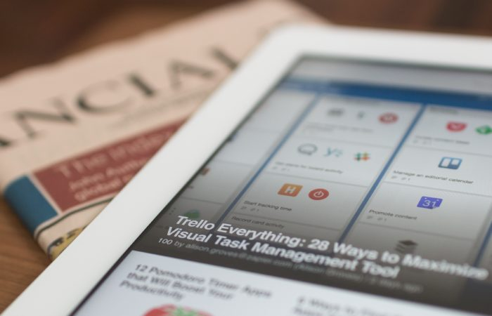 tablet and newspaper